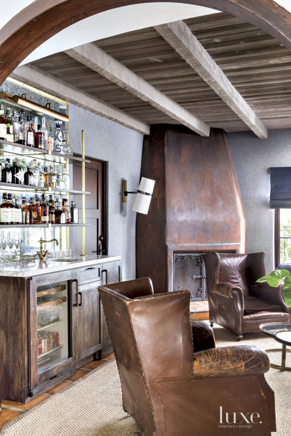 Spanish Colonial Neutral Bar Area with Leather Chairs