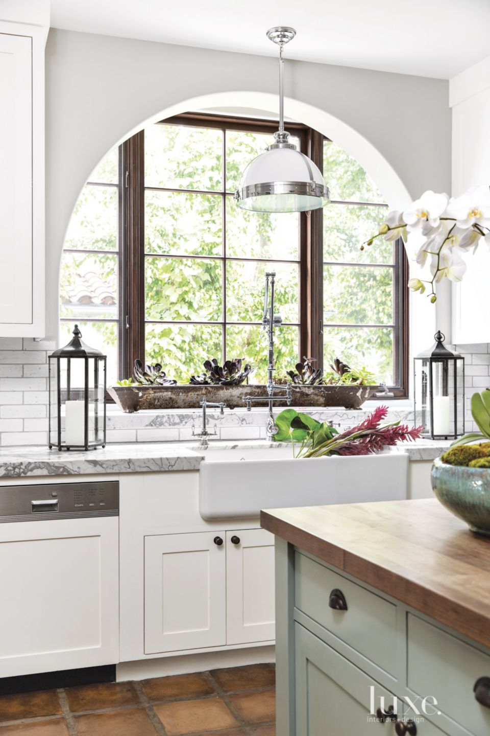 Spanish Colonial White Kitchen with Archways