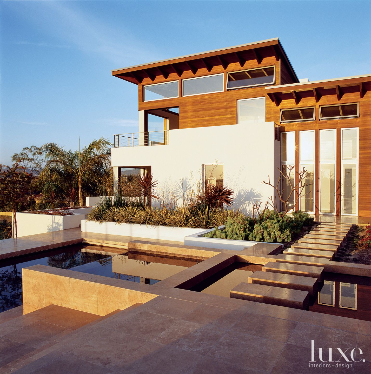 Modern Wood and Stucco Exterior Water Feature
