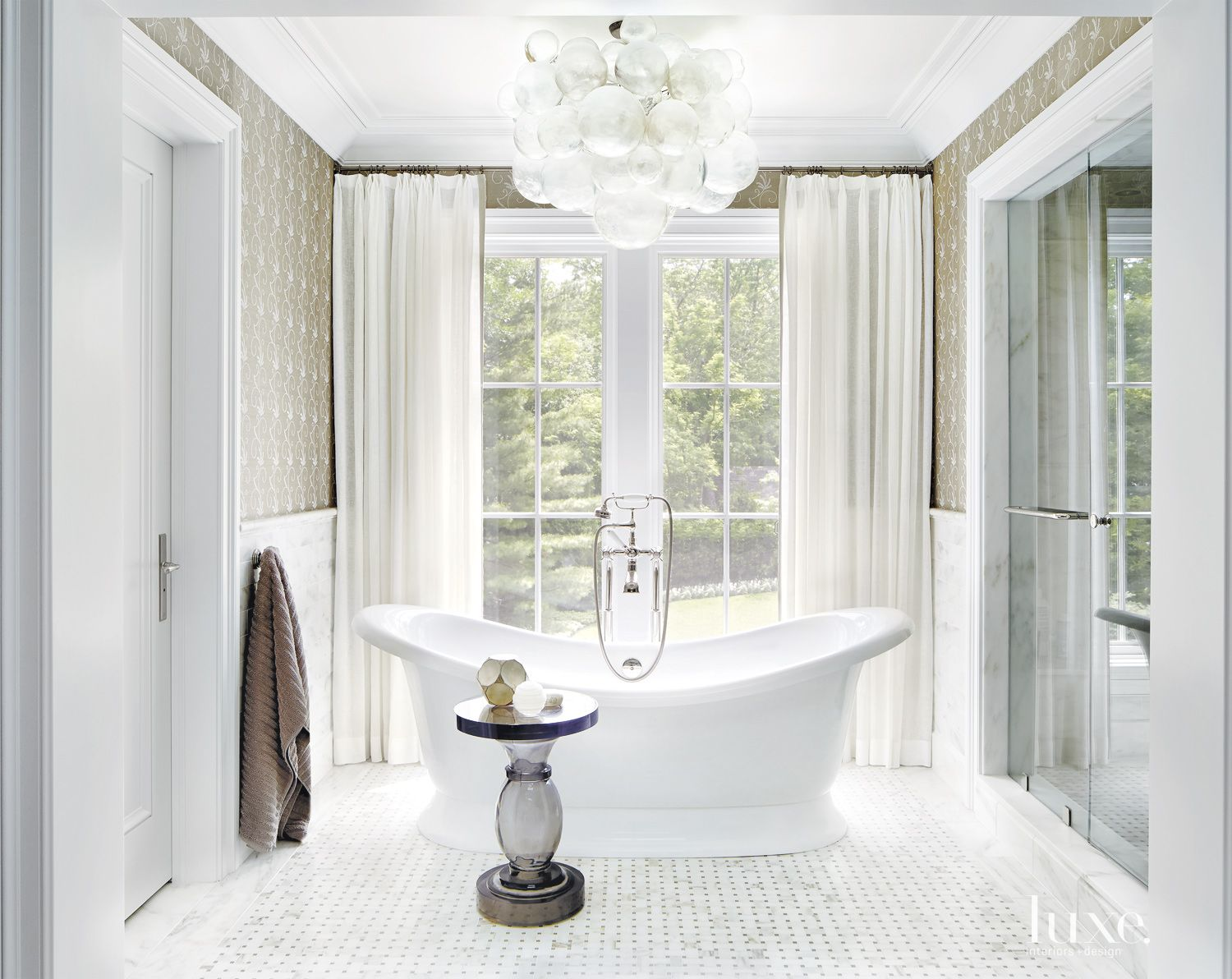 Contemporary White Bathroom with Elegant Freestanding Tub