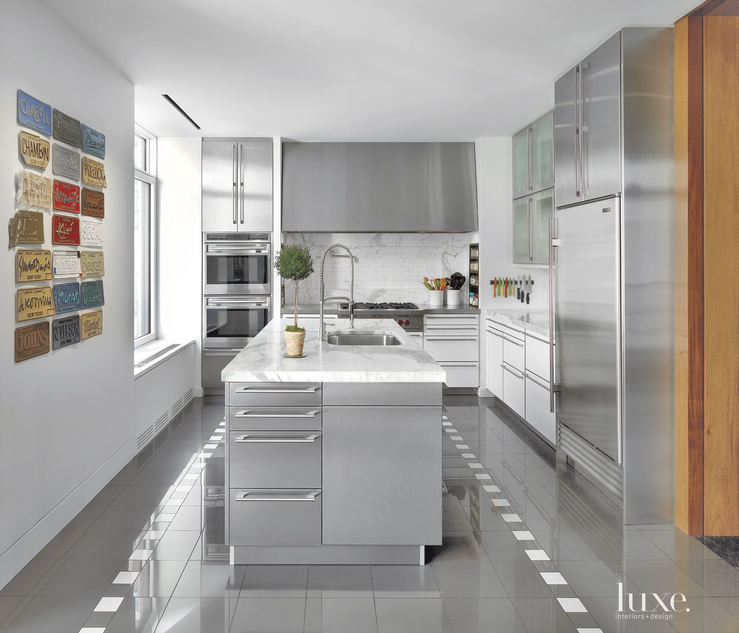 Contemporary White Kitchen with Gold Marble Counters