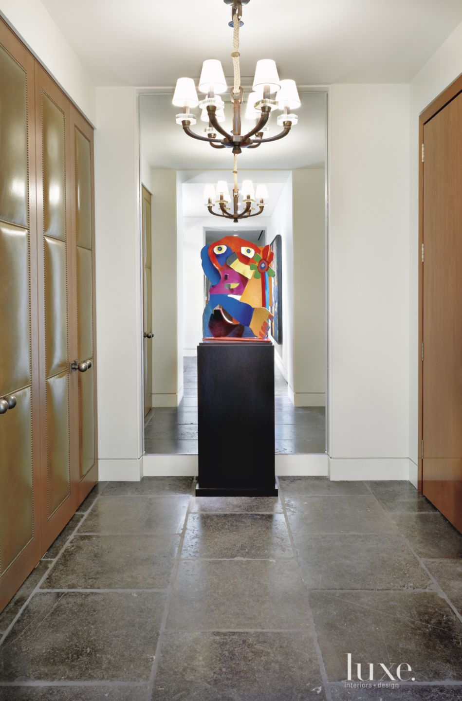 Contemporary White Entry with Leather-Paneled Doors