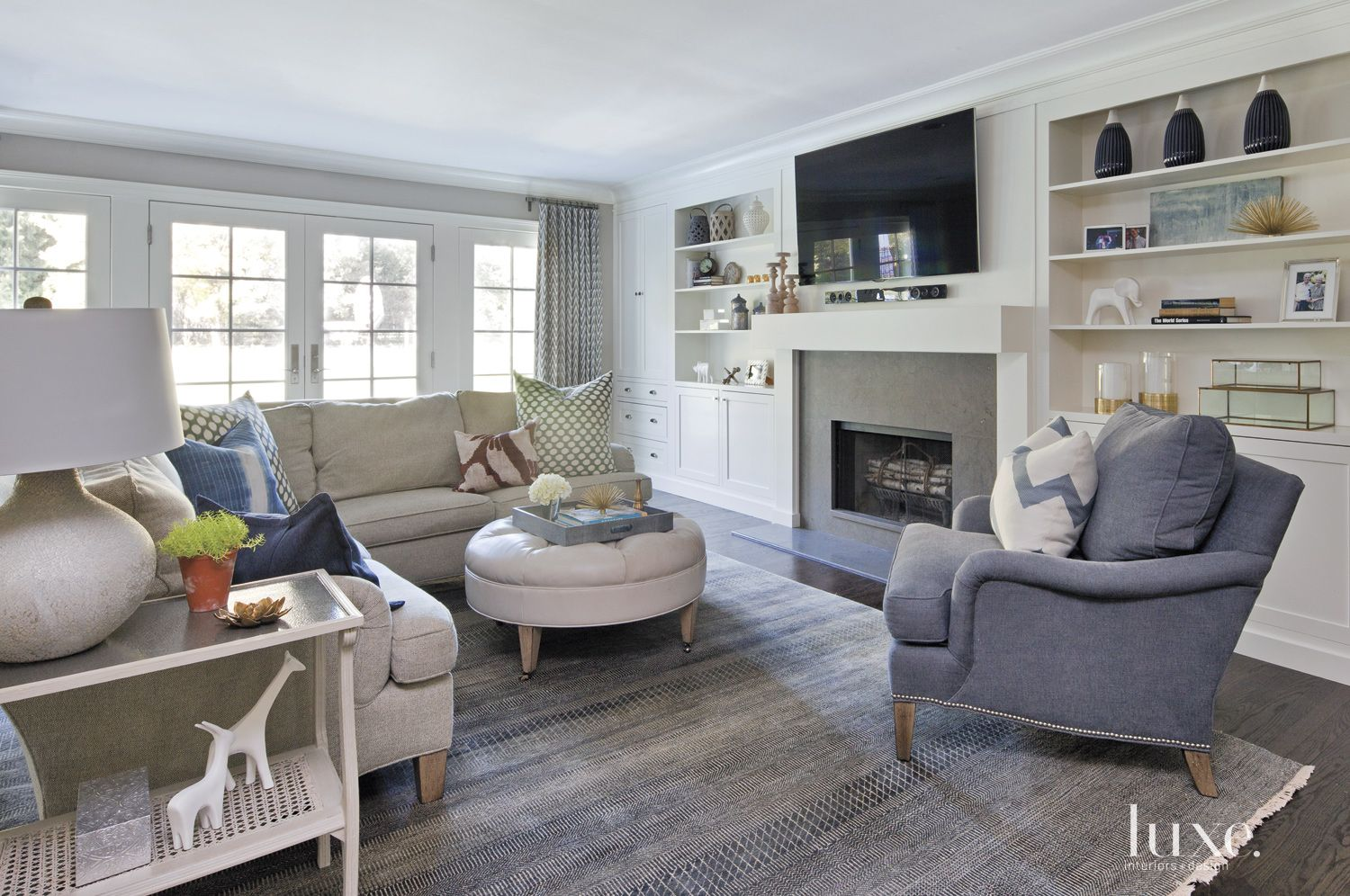 Transitional White Family Room with Built-In Shelves