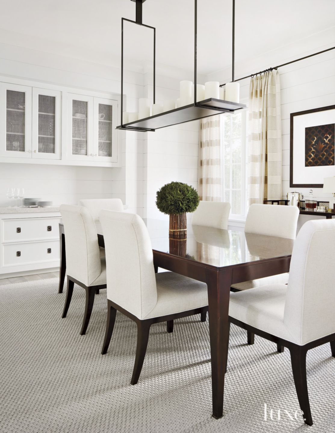 Transitional White Dining Room with Candle Light Fixture