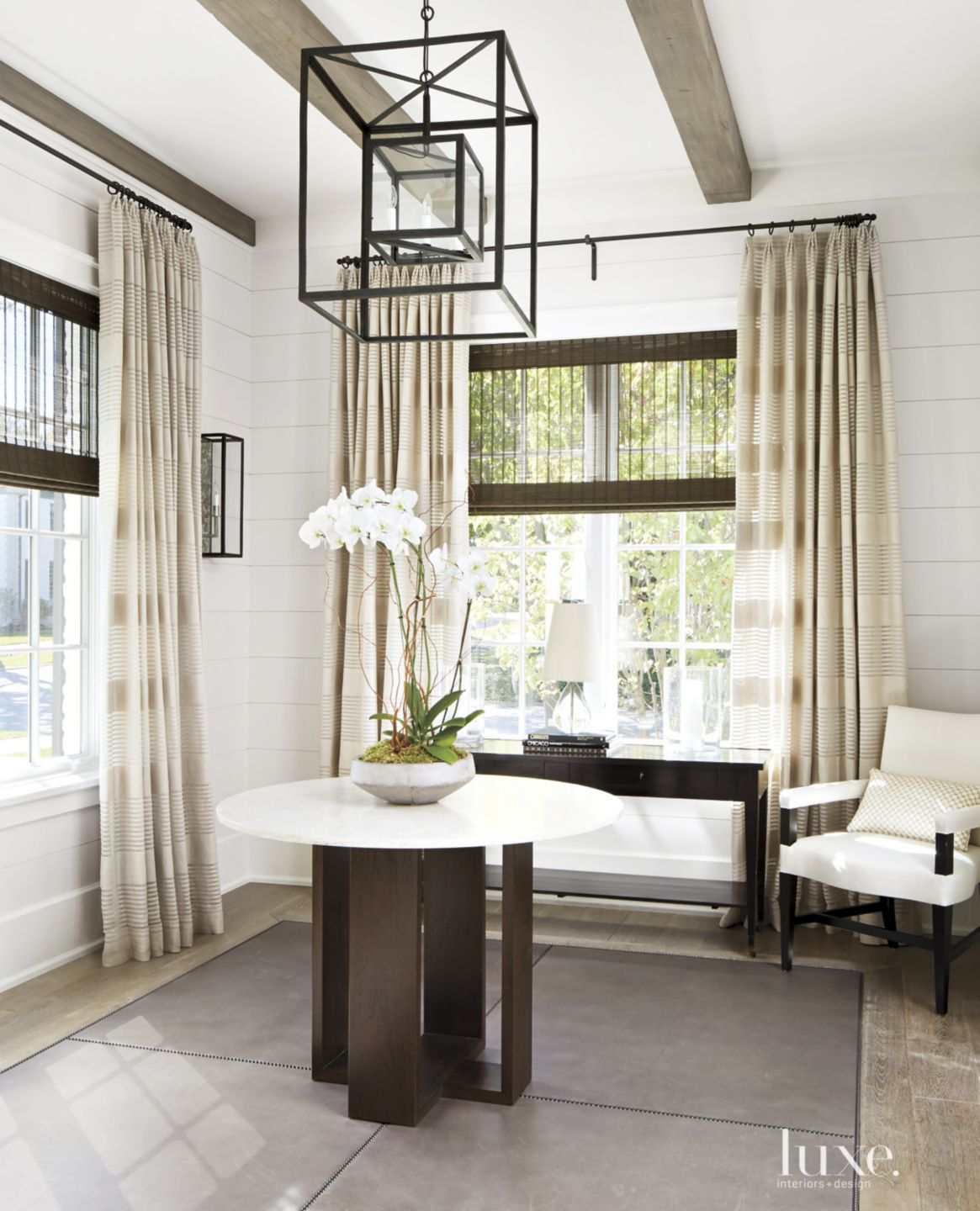Transitional White Entry with Geometric Chandelier