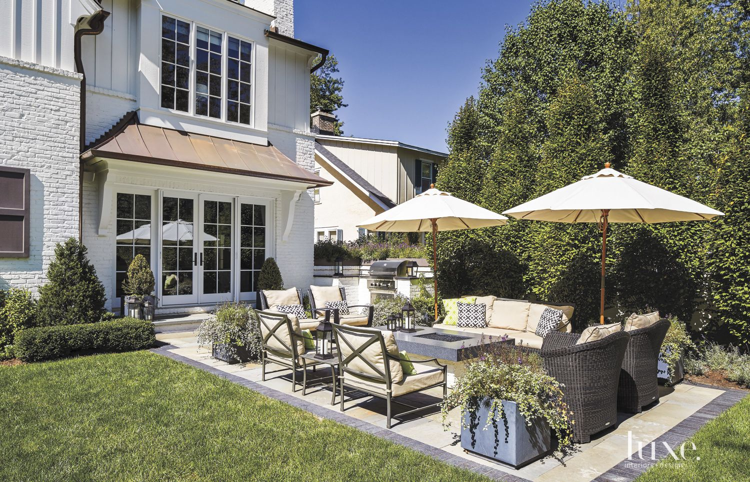 Transitional White Outdoor Seating Area with Fire Table