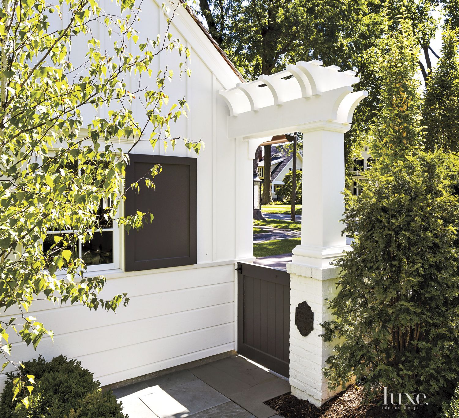 Transitional White Gate with Small Pergoia