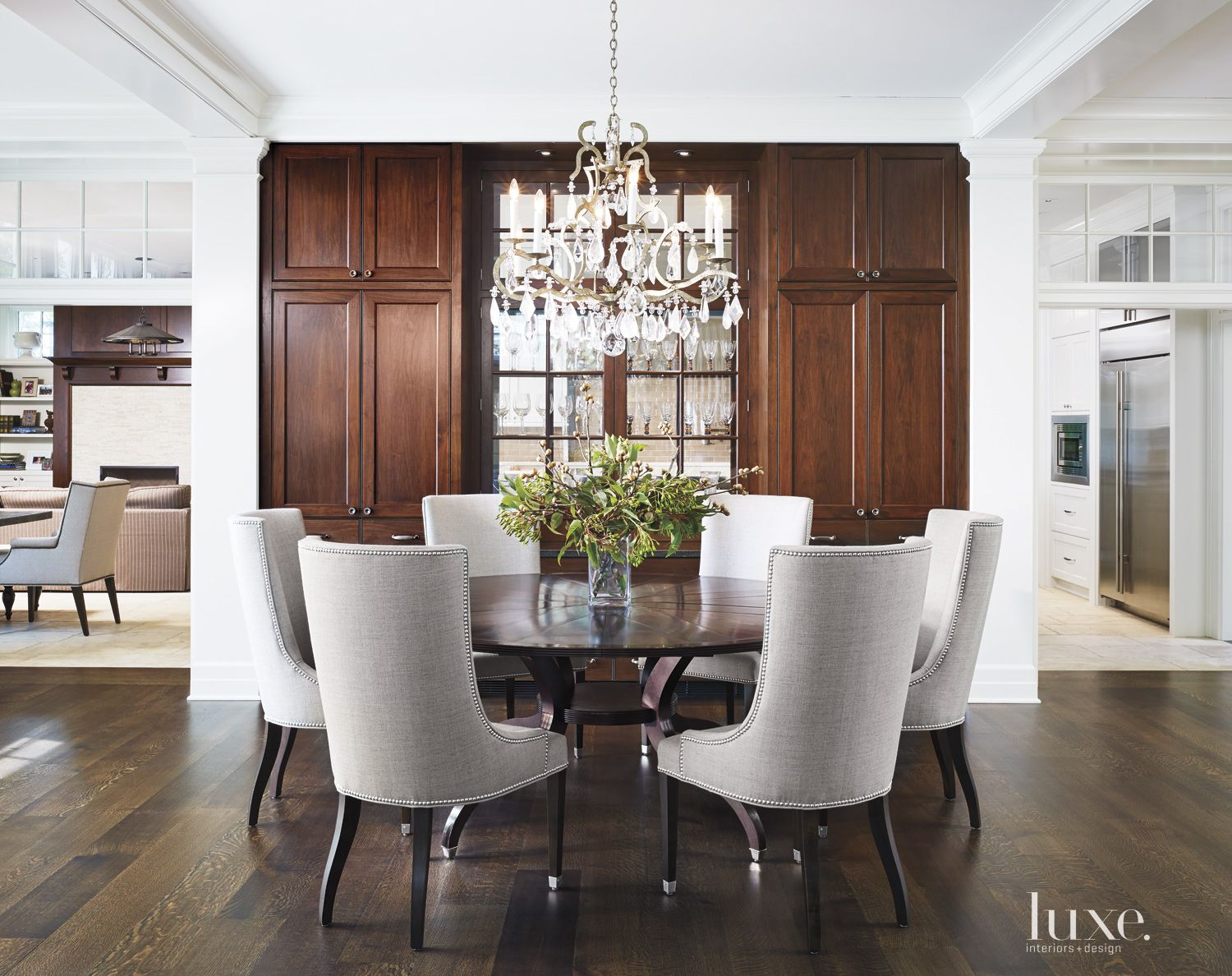 Transitional White Dining Room with Crystal Chandelier