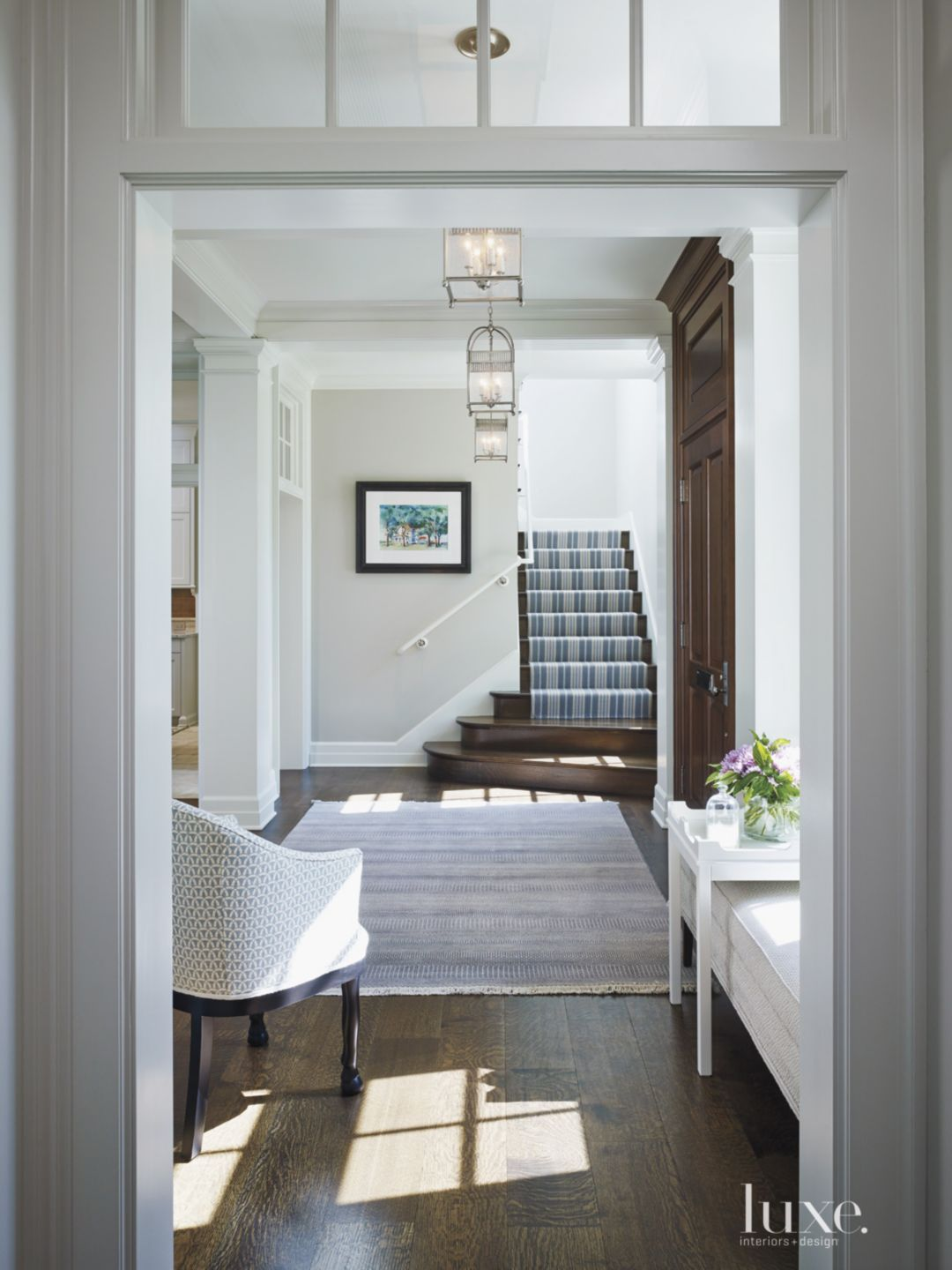 Transitional White Entry with Walnut Door