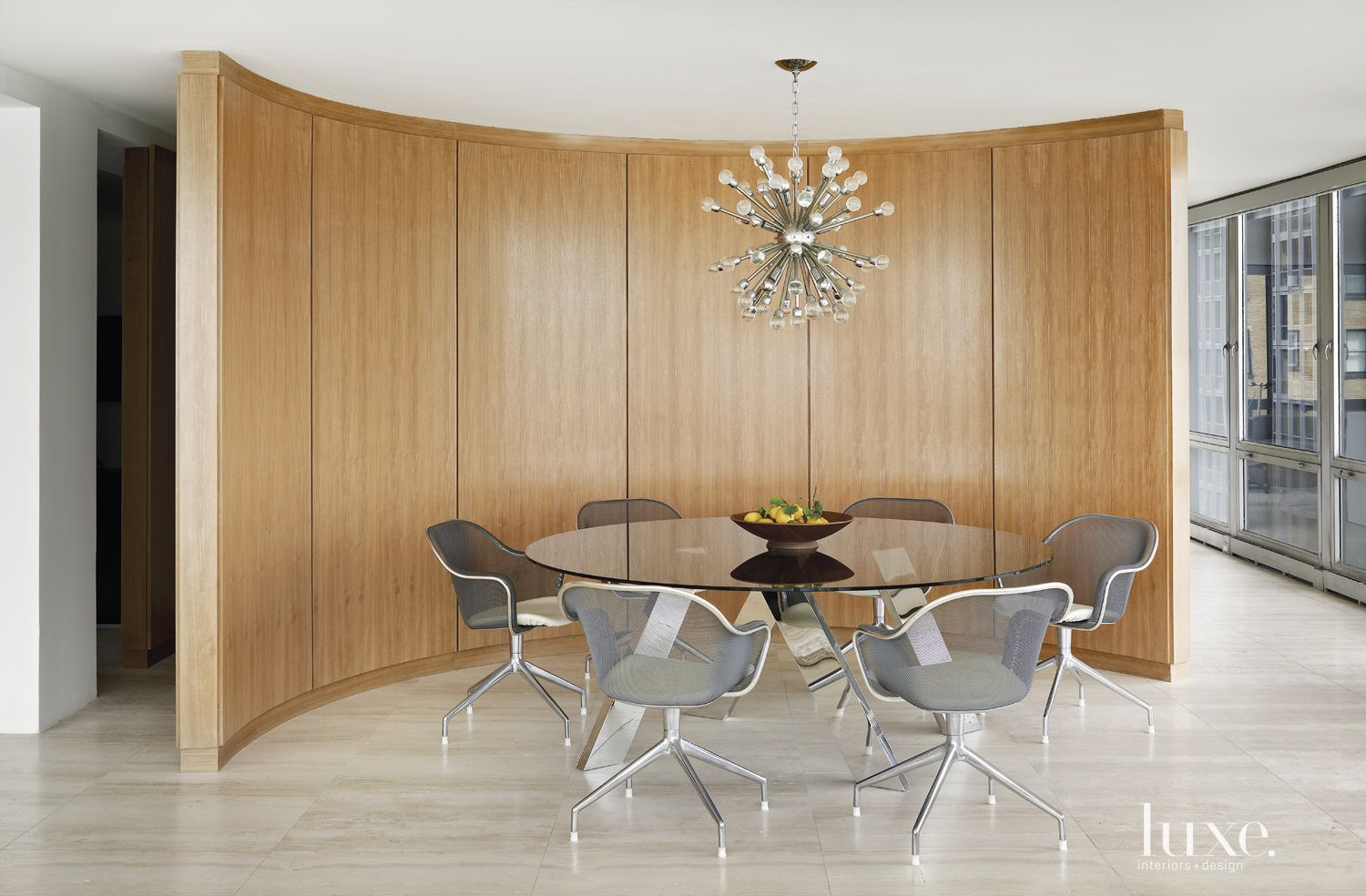 Modern Neutral Dining Area with Curved Wall