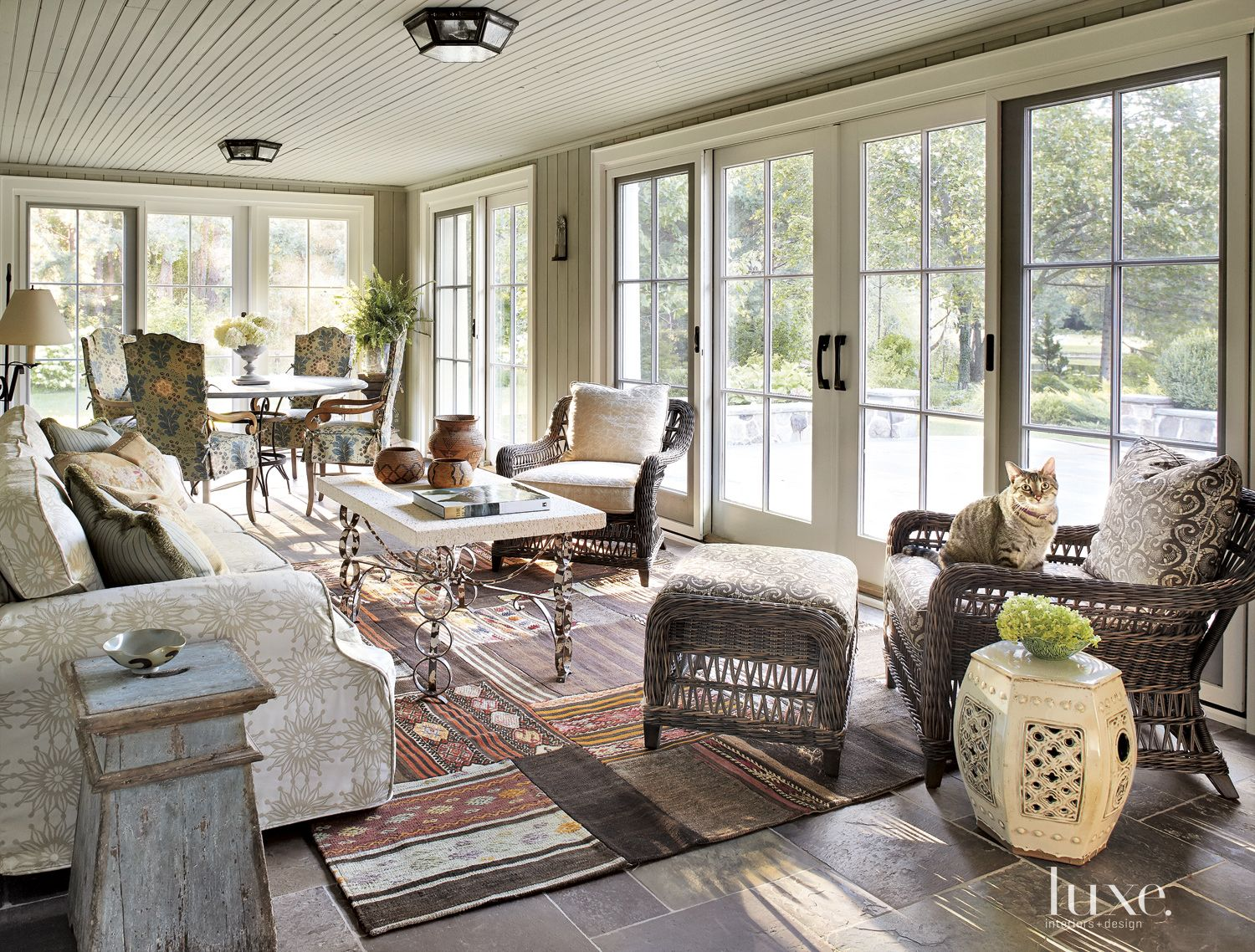 Transitional Neutral Sunroom with Kilim Rug