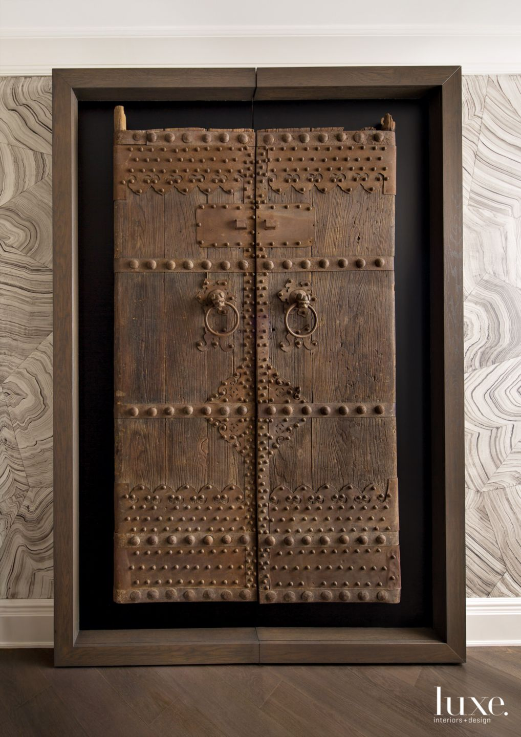 Eclectic Neutral Entry Closet with Tibetan Doors