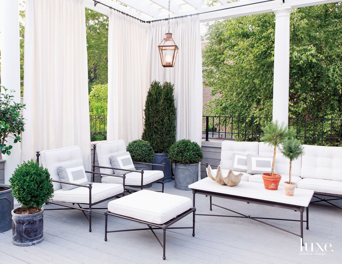 Traditional White Terrace with White Drapes
