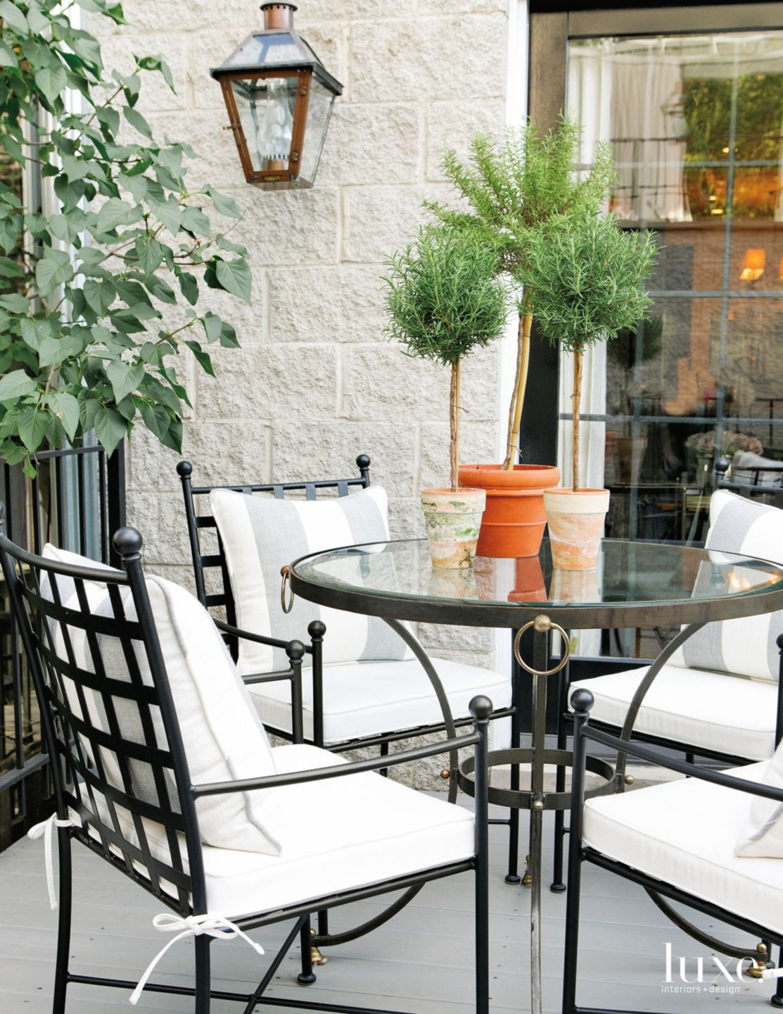 Traditional White Terrace with Vintage Dining Chairs