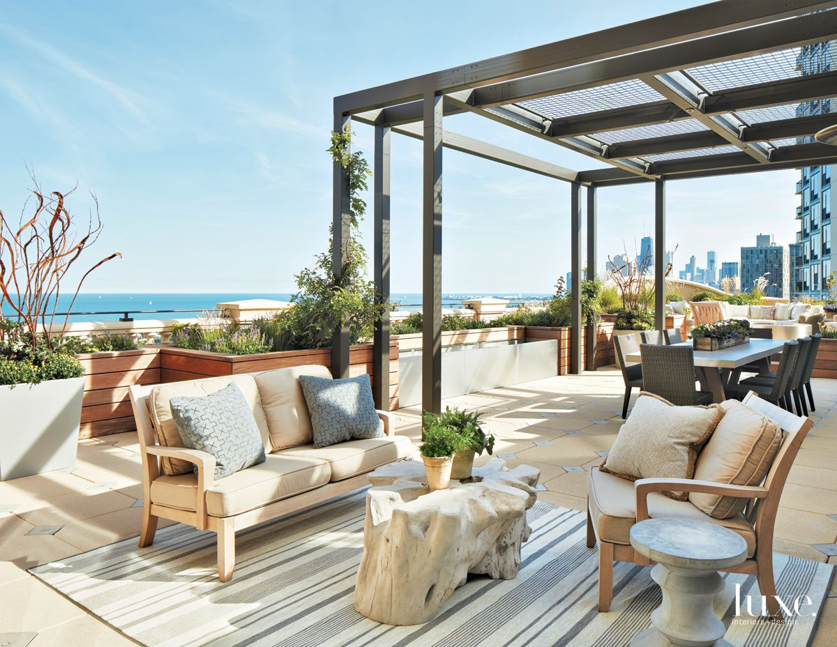 Transitional Neutral Rooftop Terrace with Metal Pergola