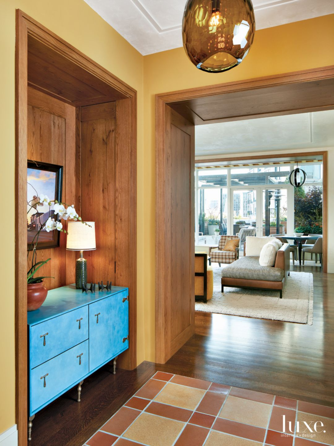 Transitional Neutral Foyer with Blue Leather Cabinet