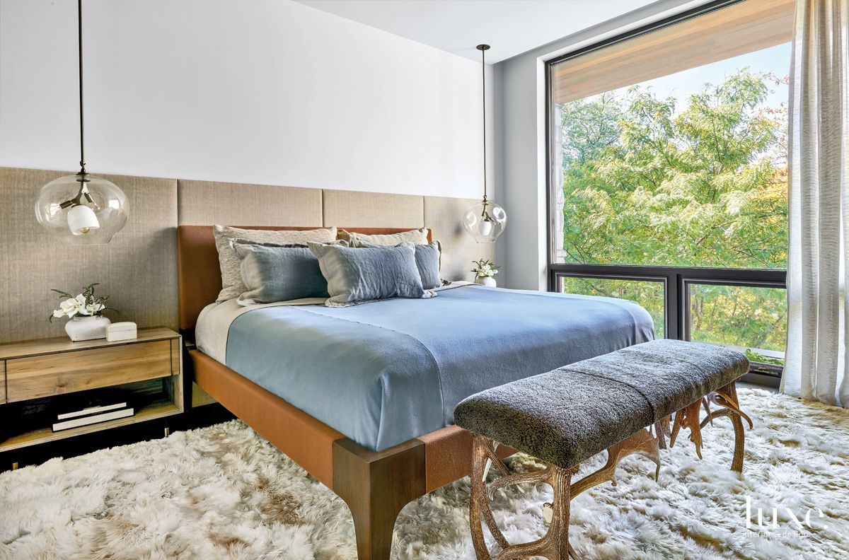Contemporary White Master Bedroom with Alpaca-Hide Rug