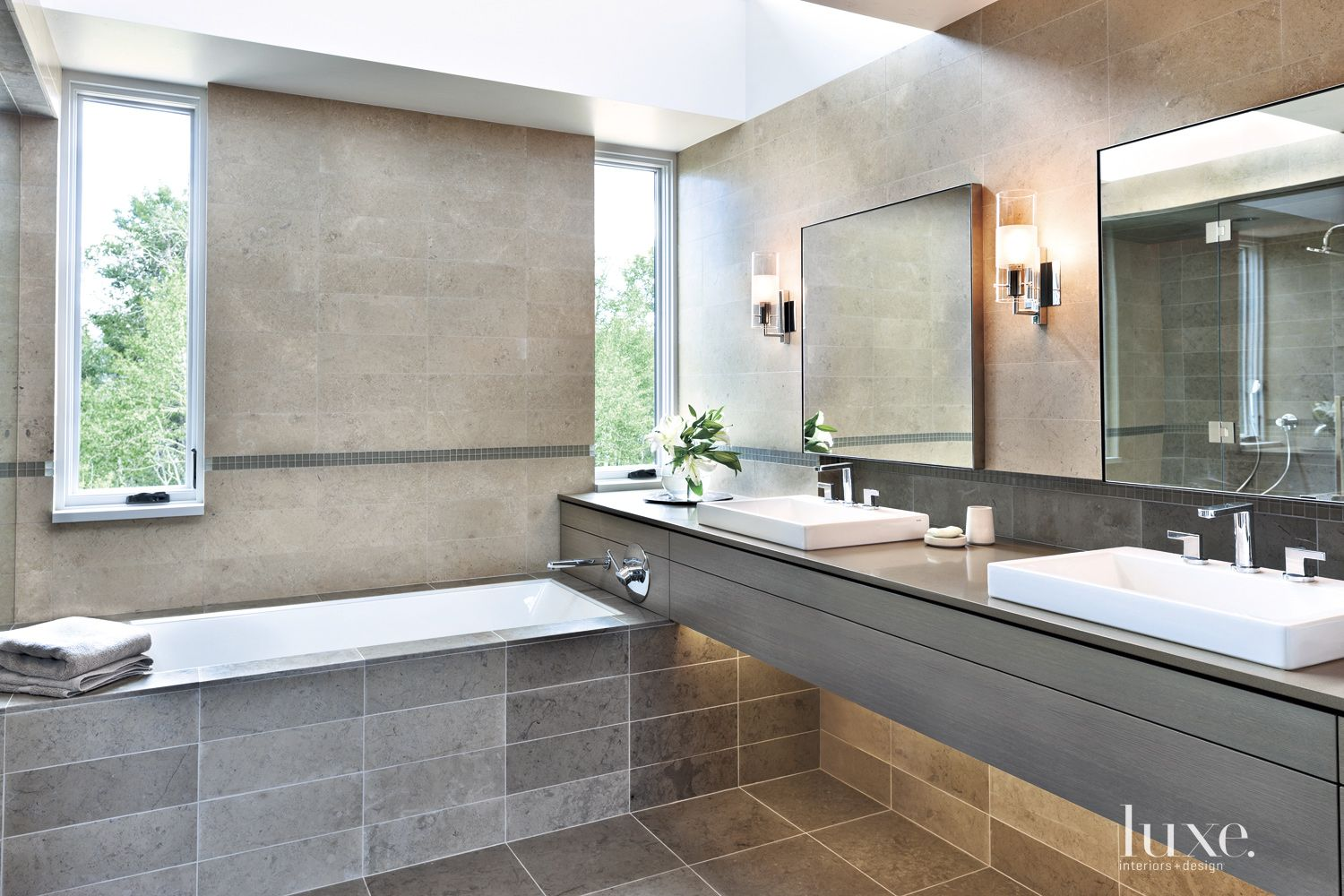 Contemporary Gray Master Bathroom with Limestone Tiling