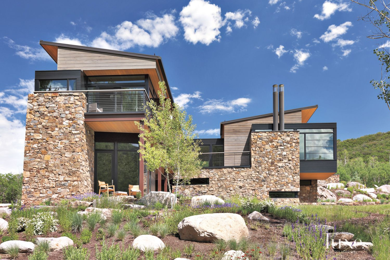 Contemporary Neutral Front Elevation with Natural Landscape