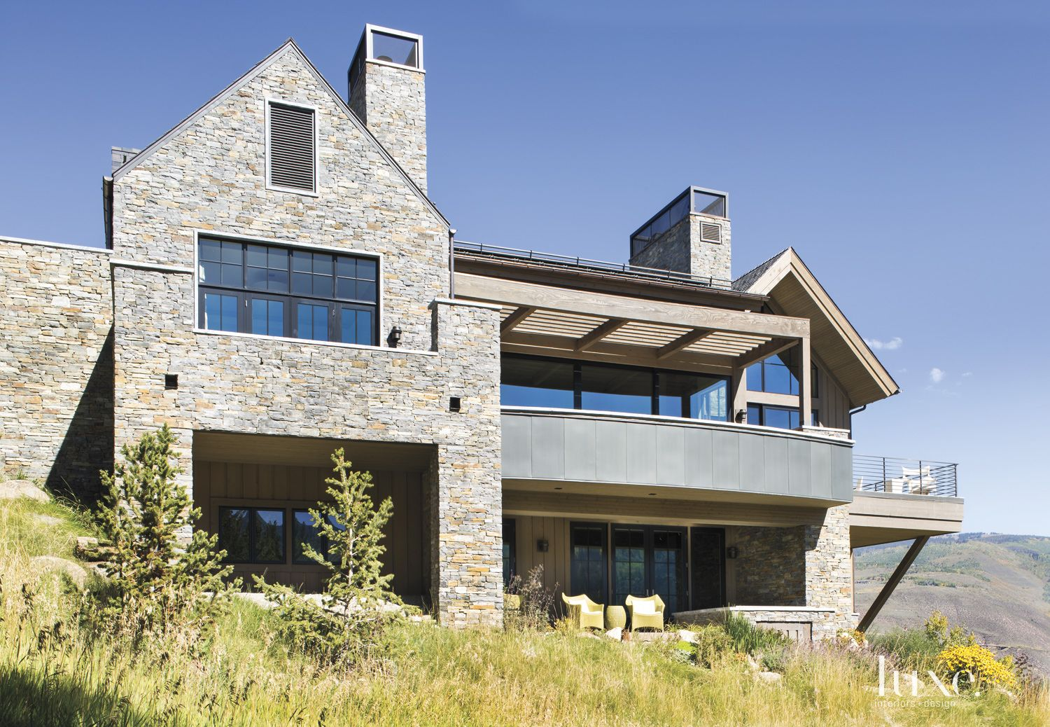 Contemporary Neutral Exterior with Stone, Wood and Metal