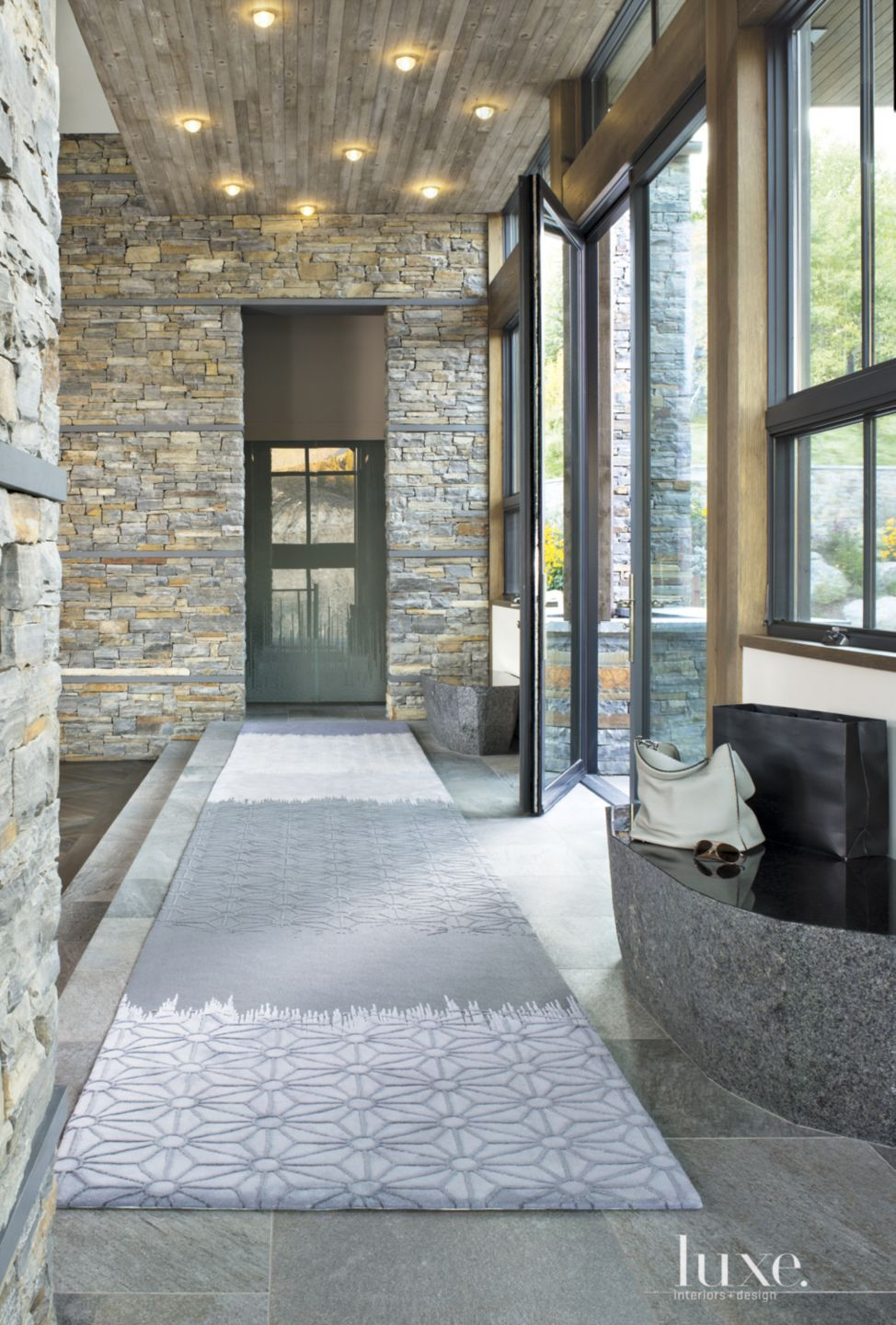 Contemporary Neutral Foyer with Rustic Stone Walls