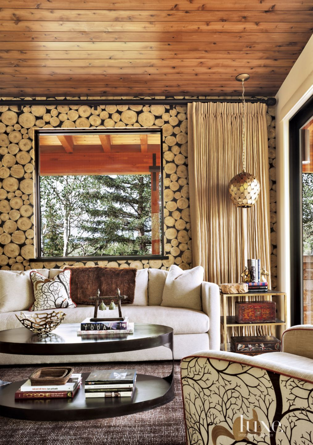 Eclectic Family Room with Log Wallpaper