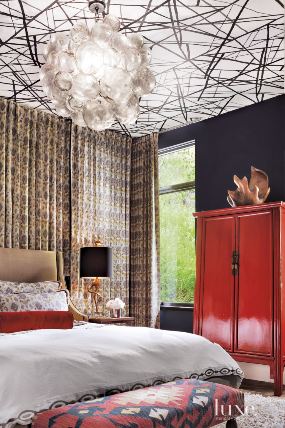 Eclectic Black Bedroom with Red Accents