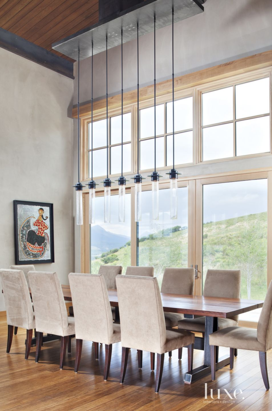 Contemporary Neutral Dining Area with Suspended Pendants