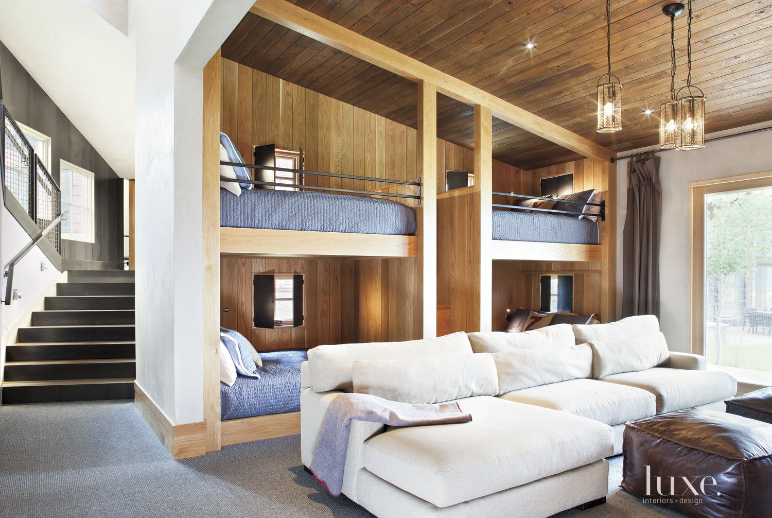 Contemporary Neutral Bunkroom with Slanted Ceiling