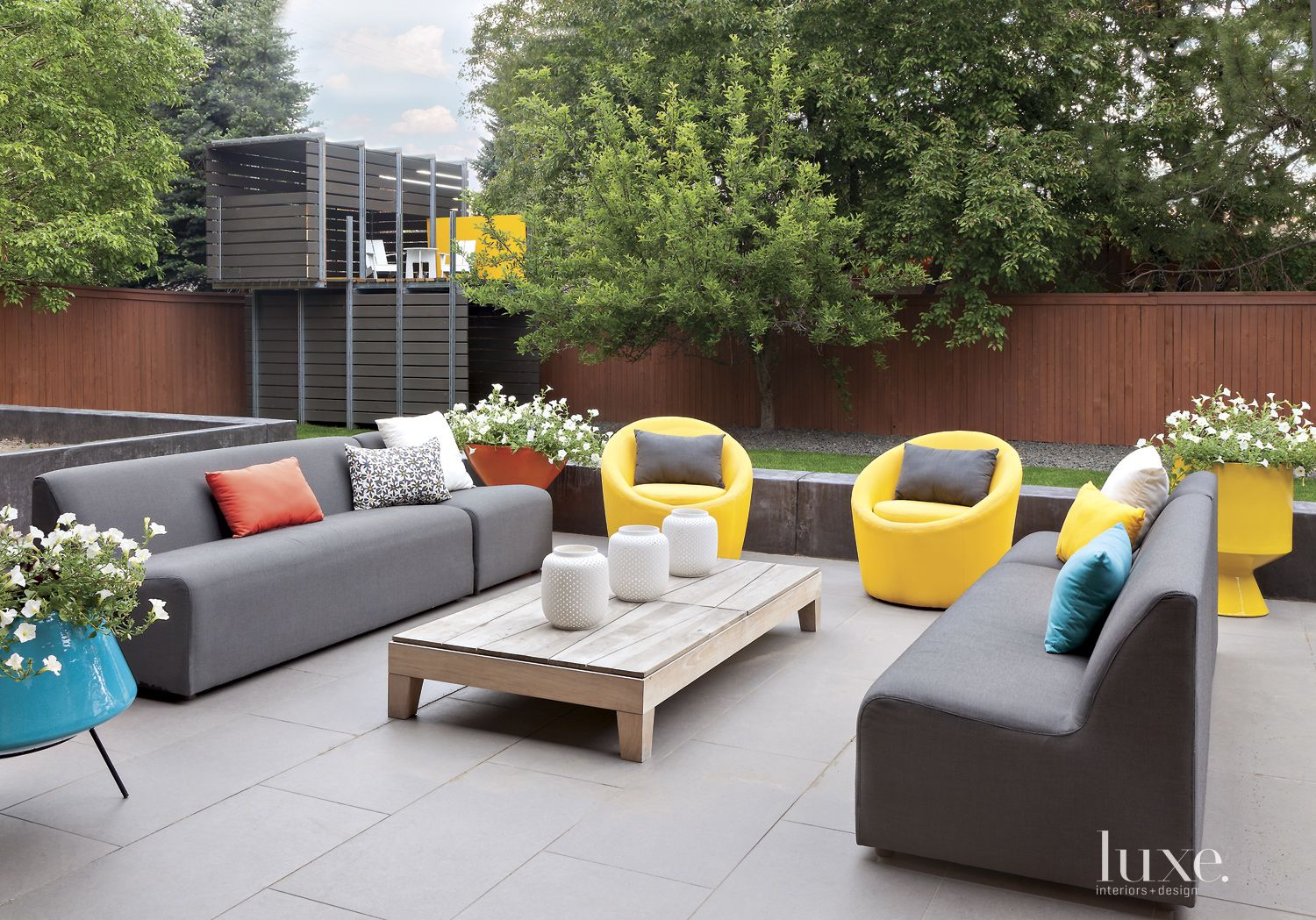 Modern Neutral Patio with Yellow Swivel Chairs