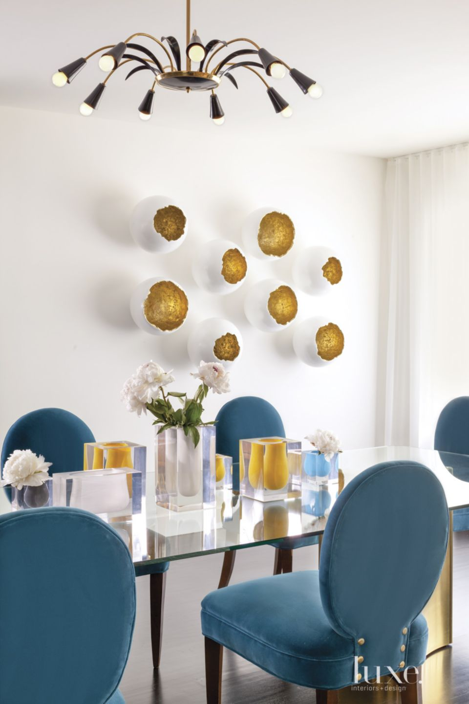 Modern Neutral Dining Room with Wall Sculptures