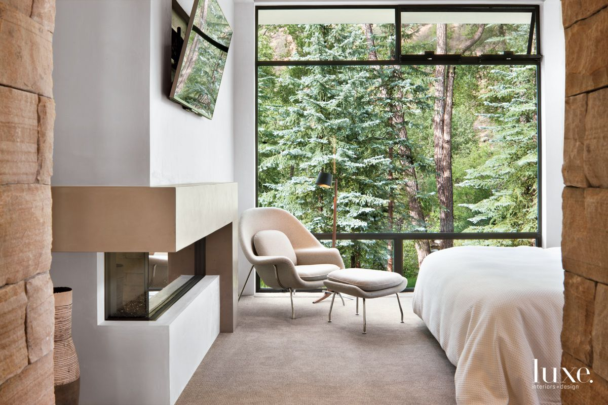 Contemporary White Bedroom with Picturesque Woodland Views