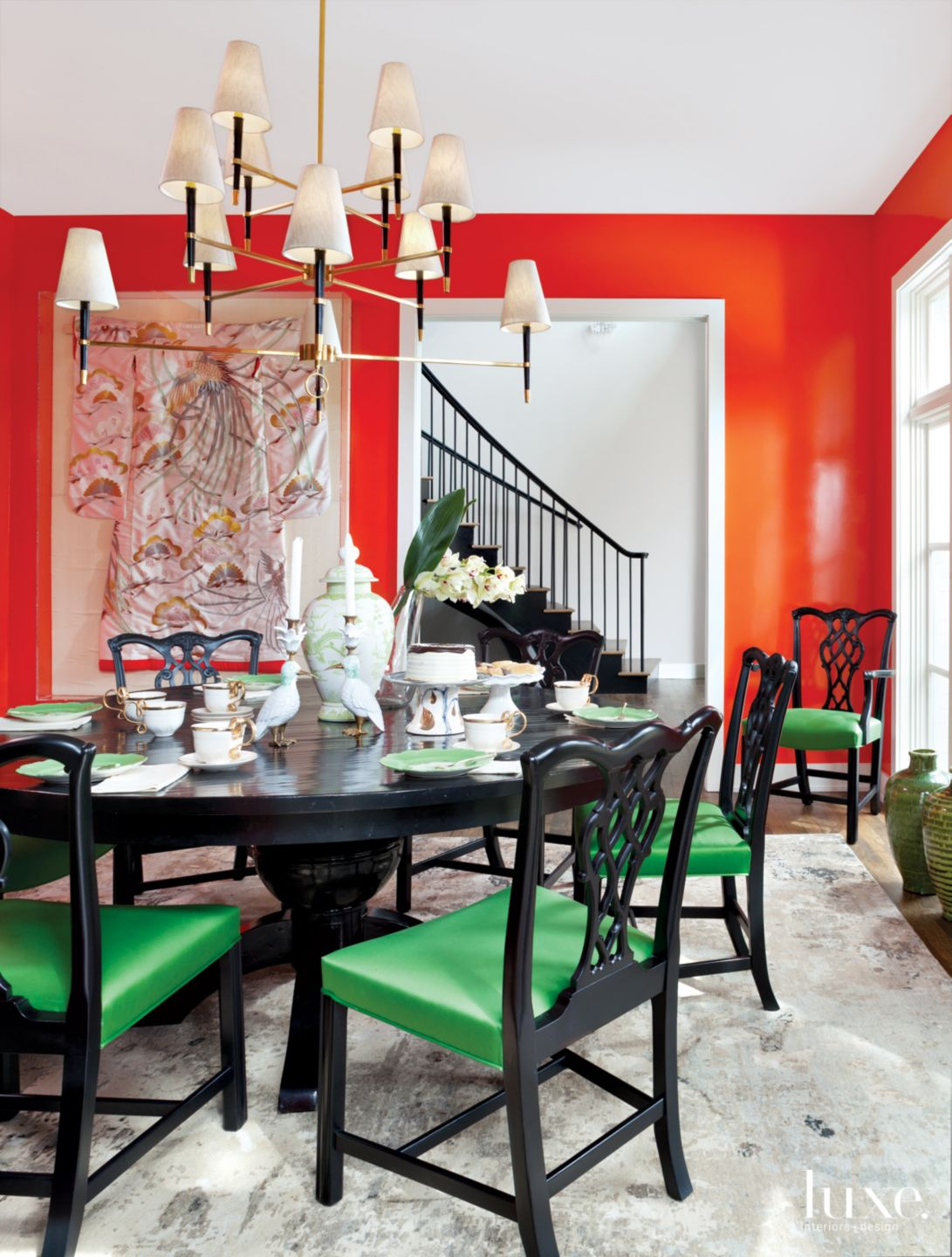 Eclectic Orange Dining Room with Chandelier
