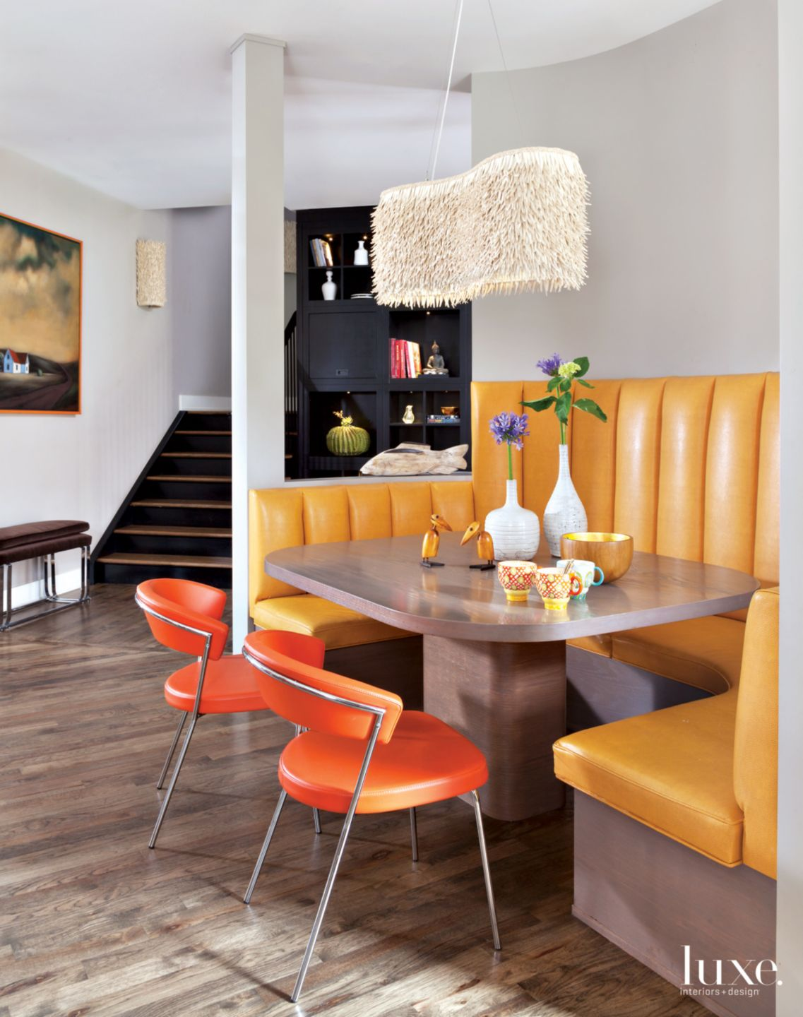 Eclectic Gray Breakfast Area with Yellow Leather Banquette