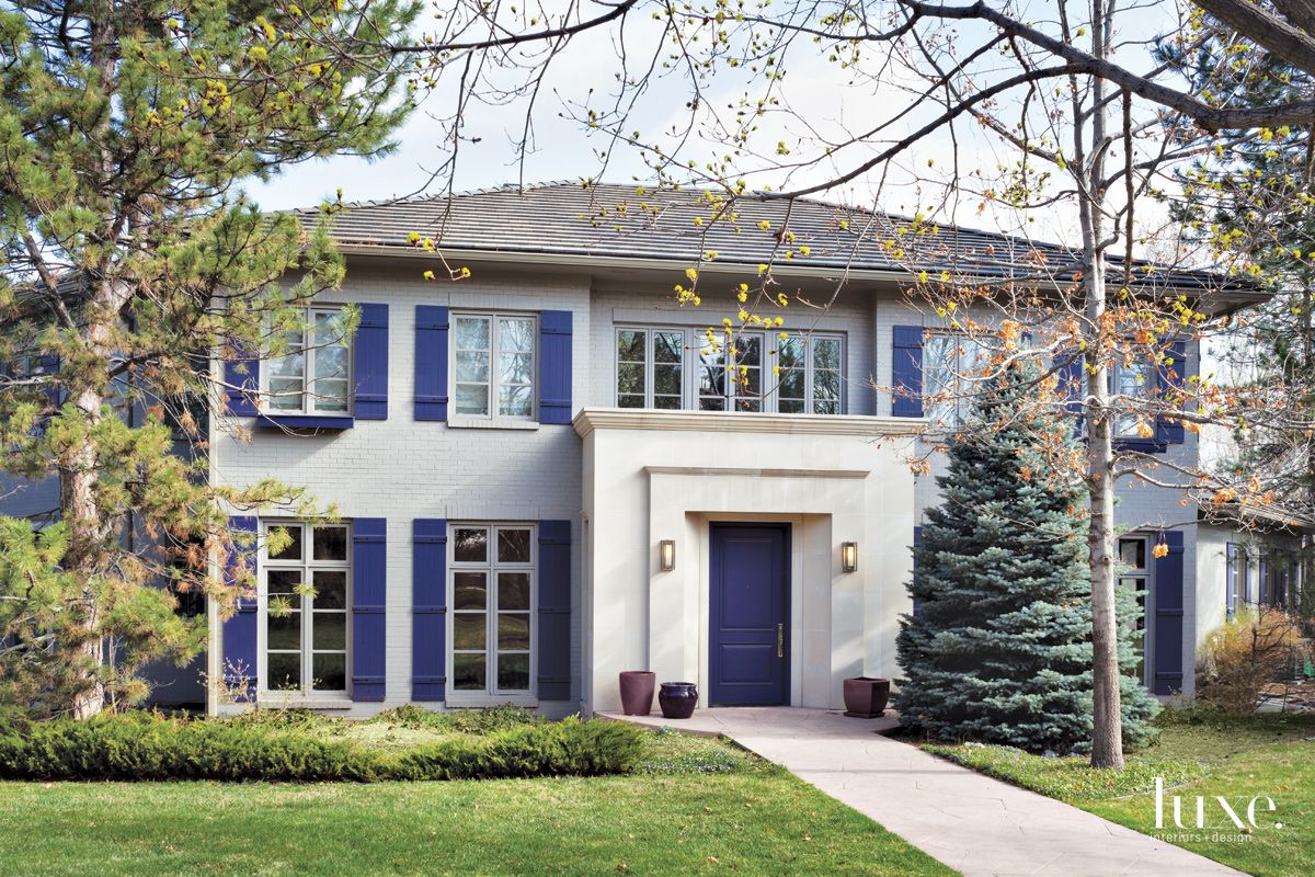 Traditional Gray Exterior with Purple Front Door and Shutters