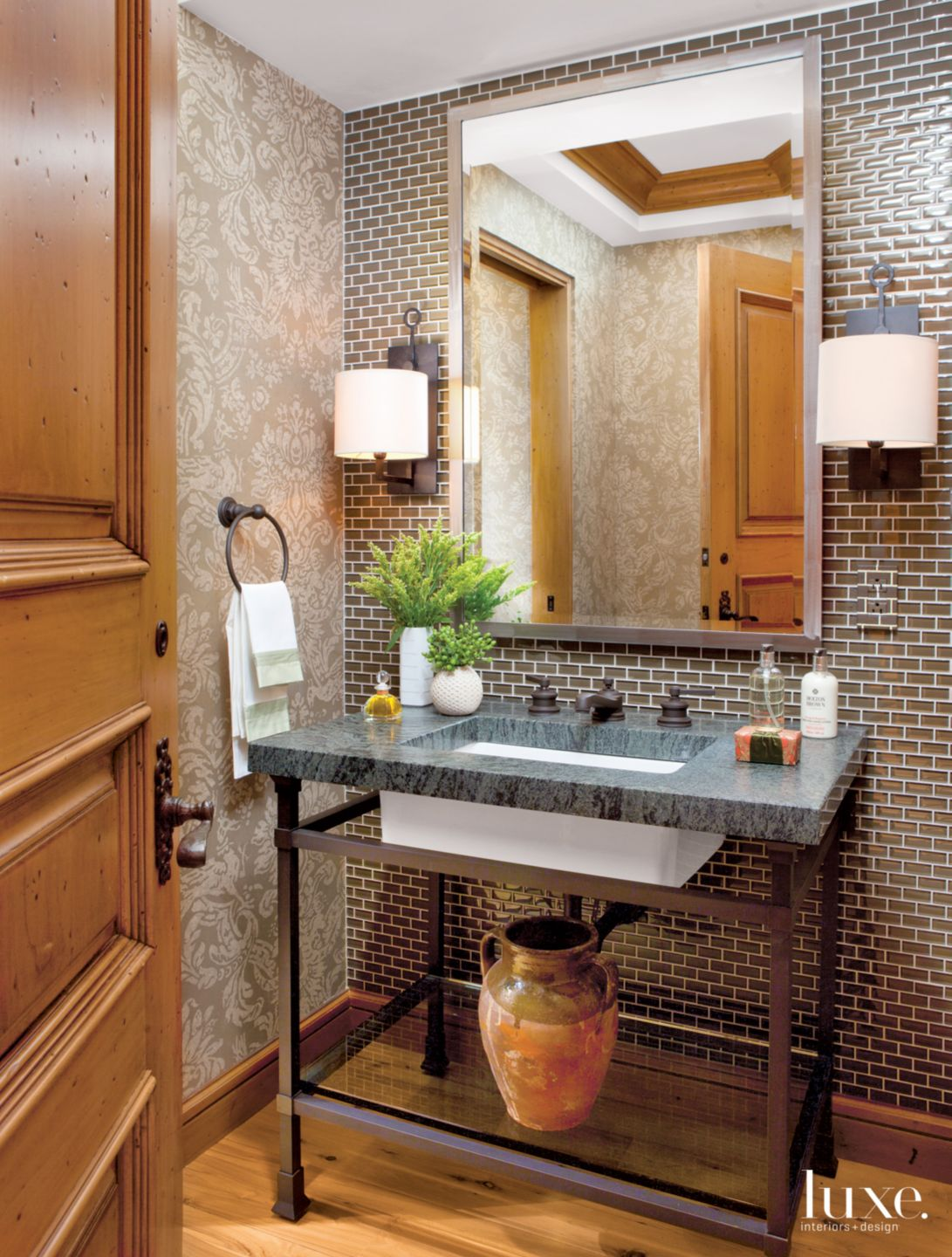Contemporary Neutral Powder Room with Brown Glass Tile Wall