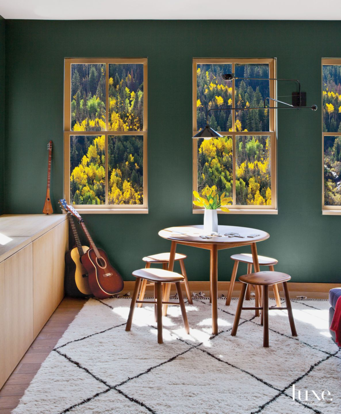 Modern Green Den Vignette with Round Wood Table