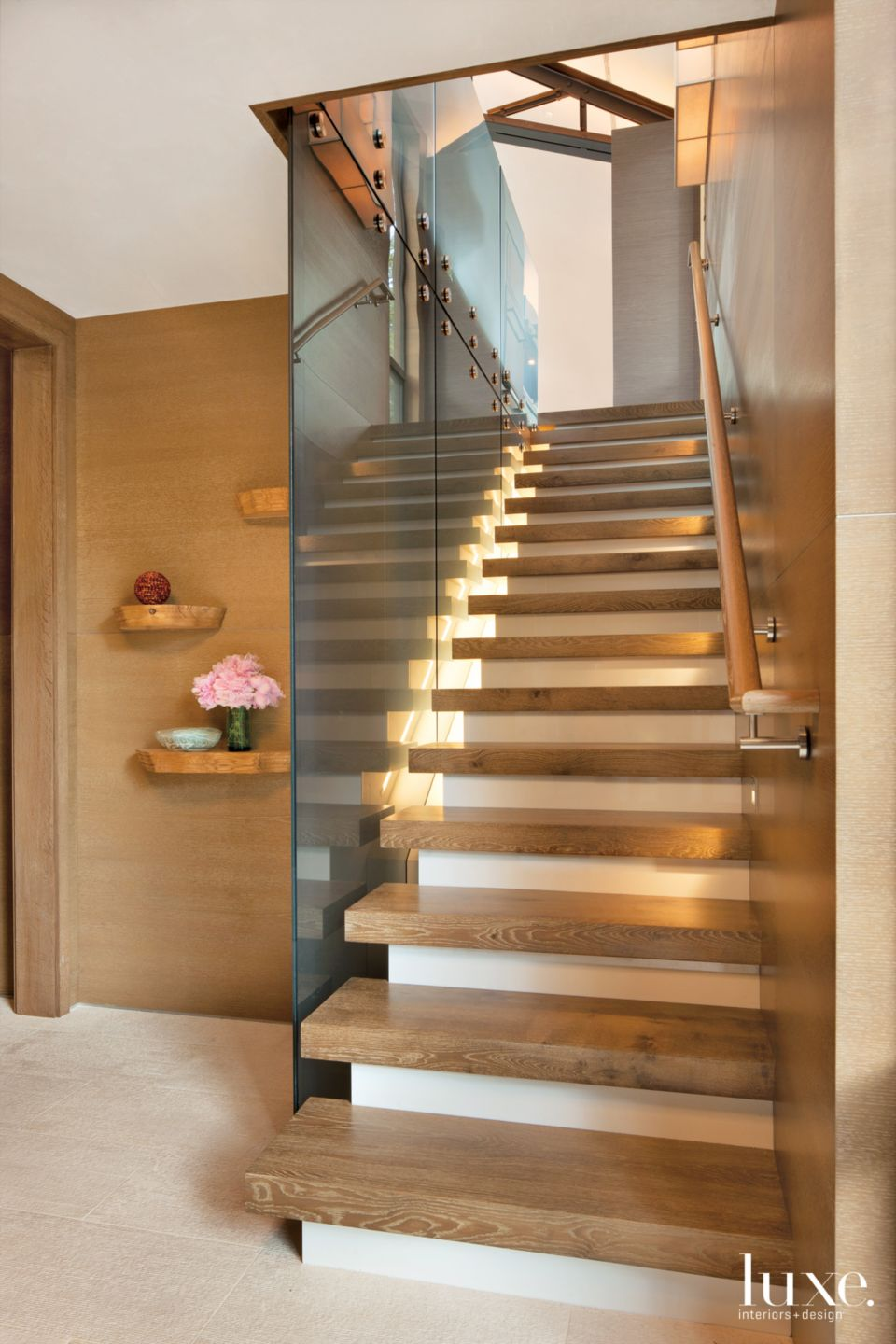 Contemporary Neutral Stairway with Blue-Glass Panels