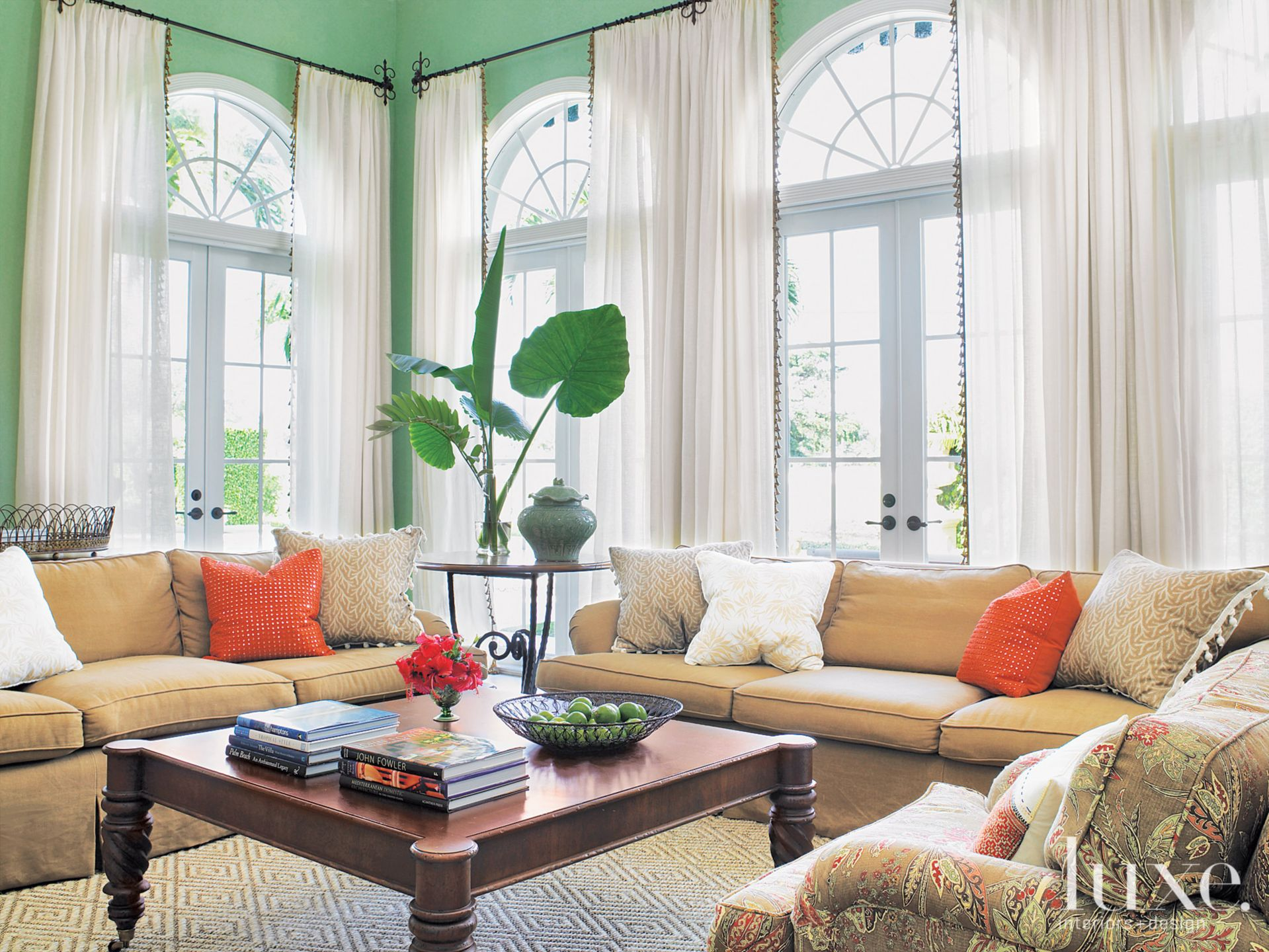 Mediterranean Green Family Room with Floral Chairs