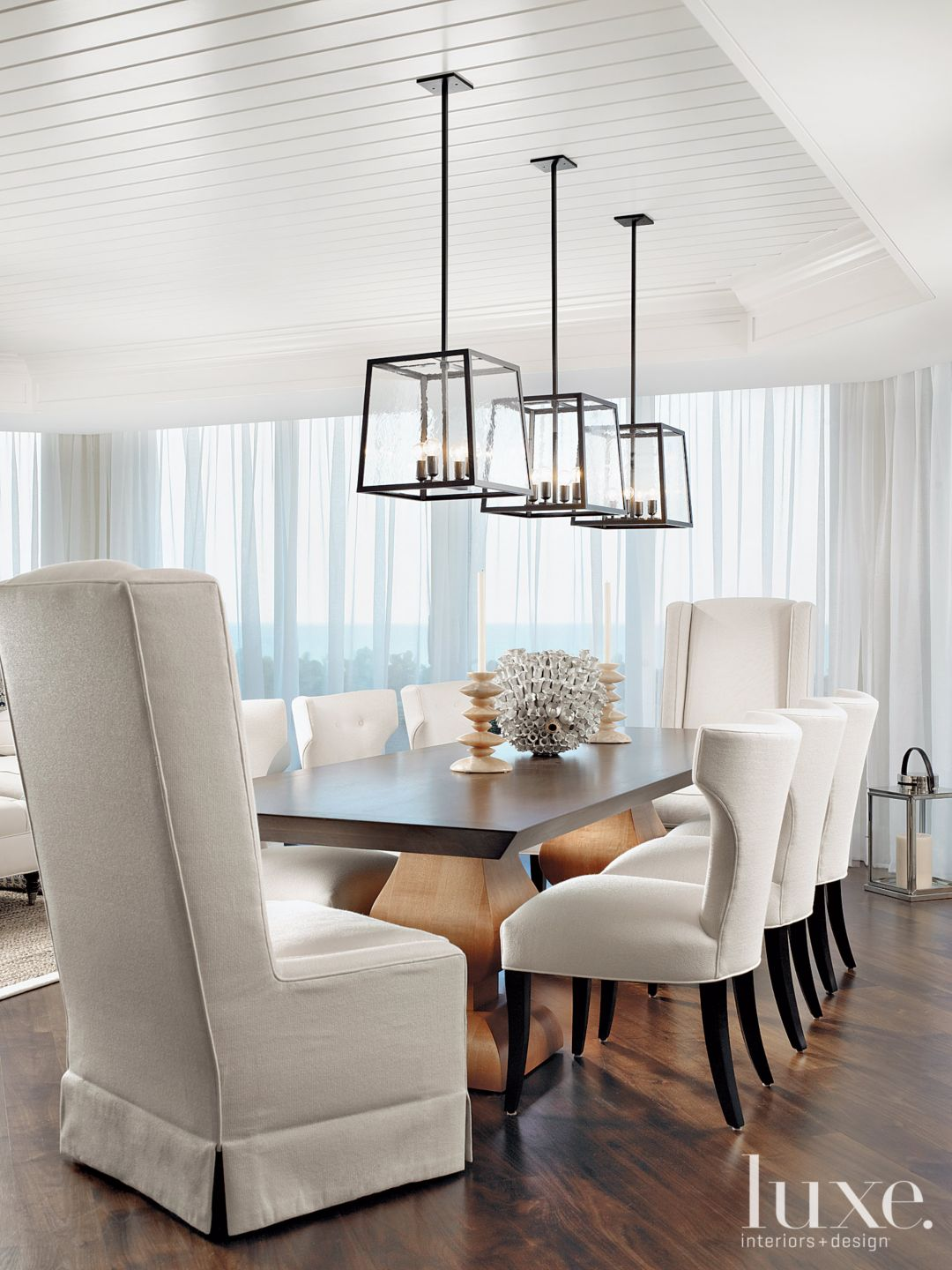Contemporary White Dining Room with Klismos Chairs