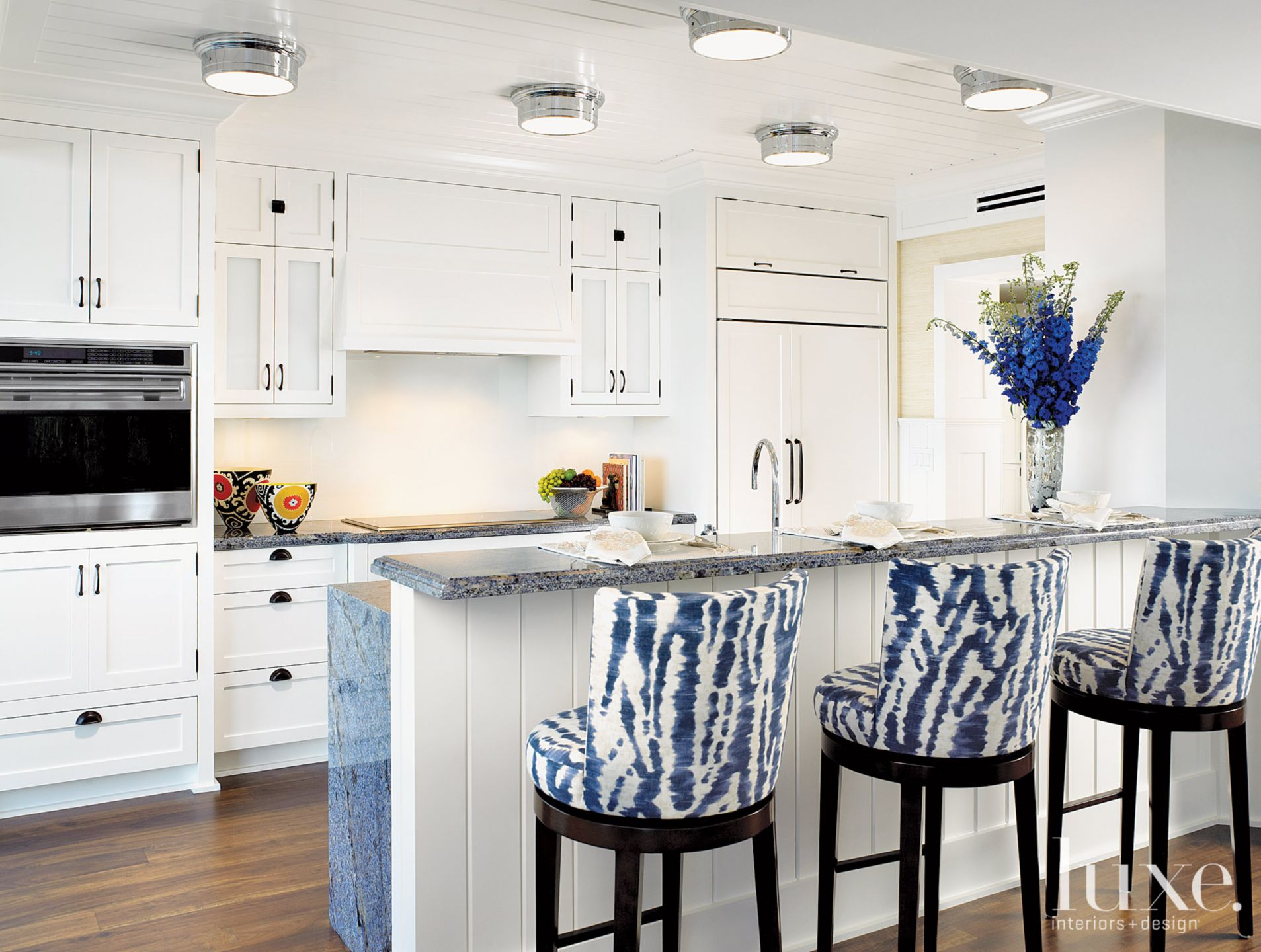 Contemporary White Kitchen with Linen Barstools