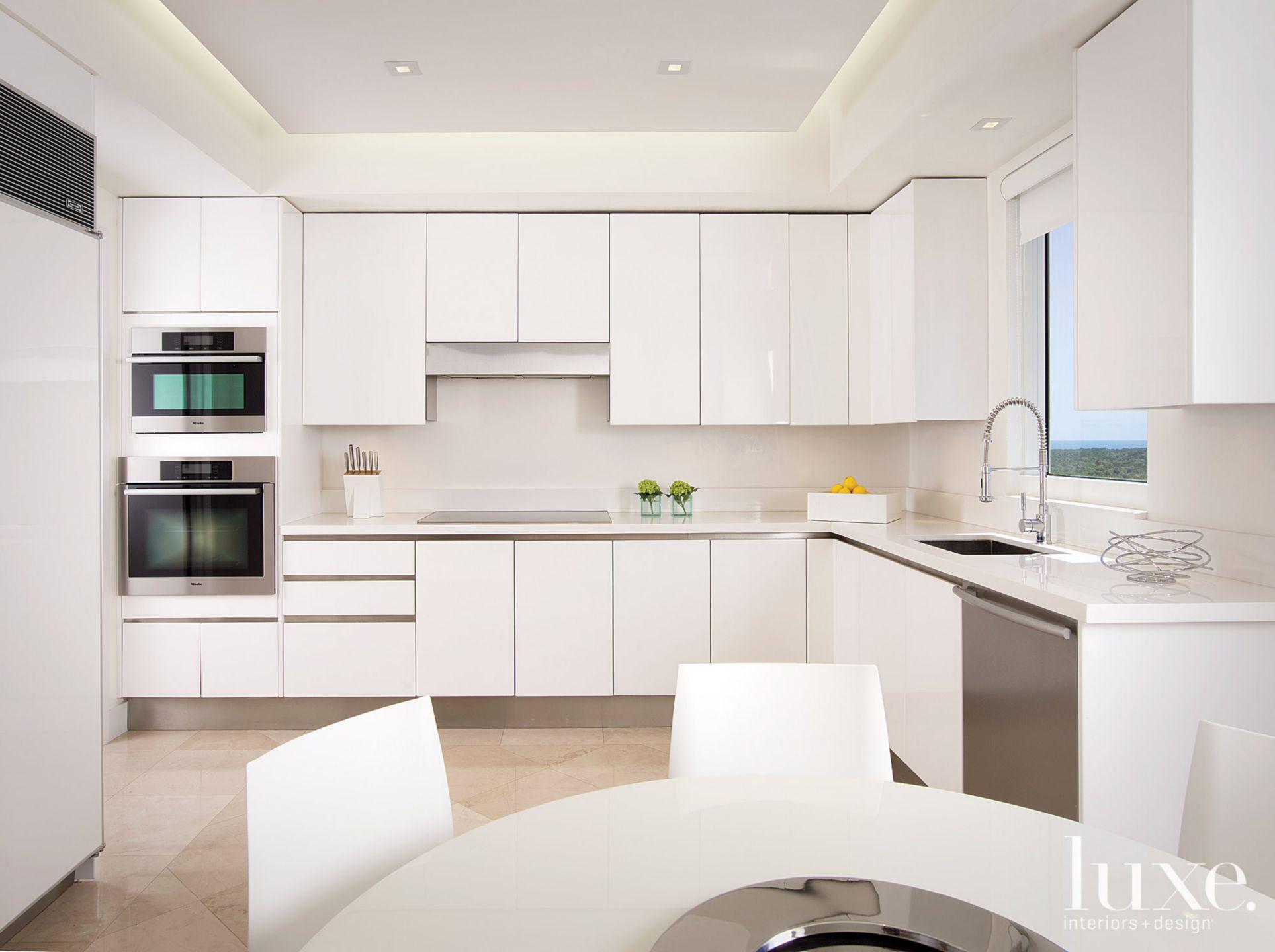 Modern White Kitchen with Round Table