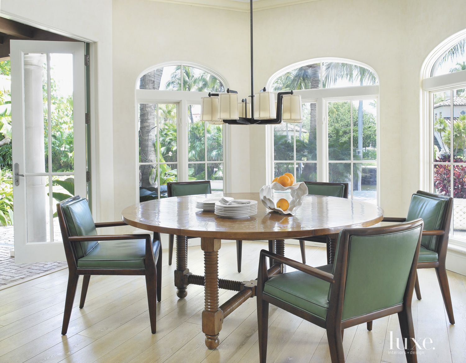 Traditional White Breakfast Area with Arched Windows