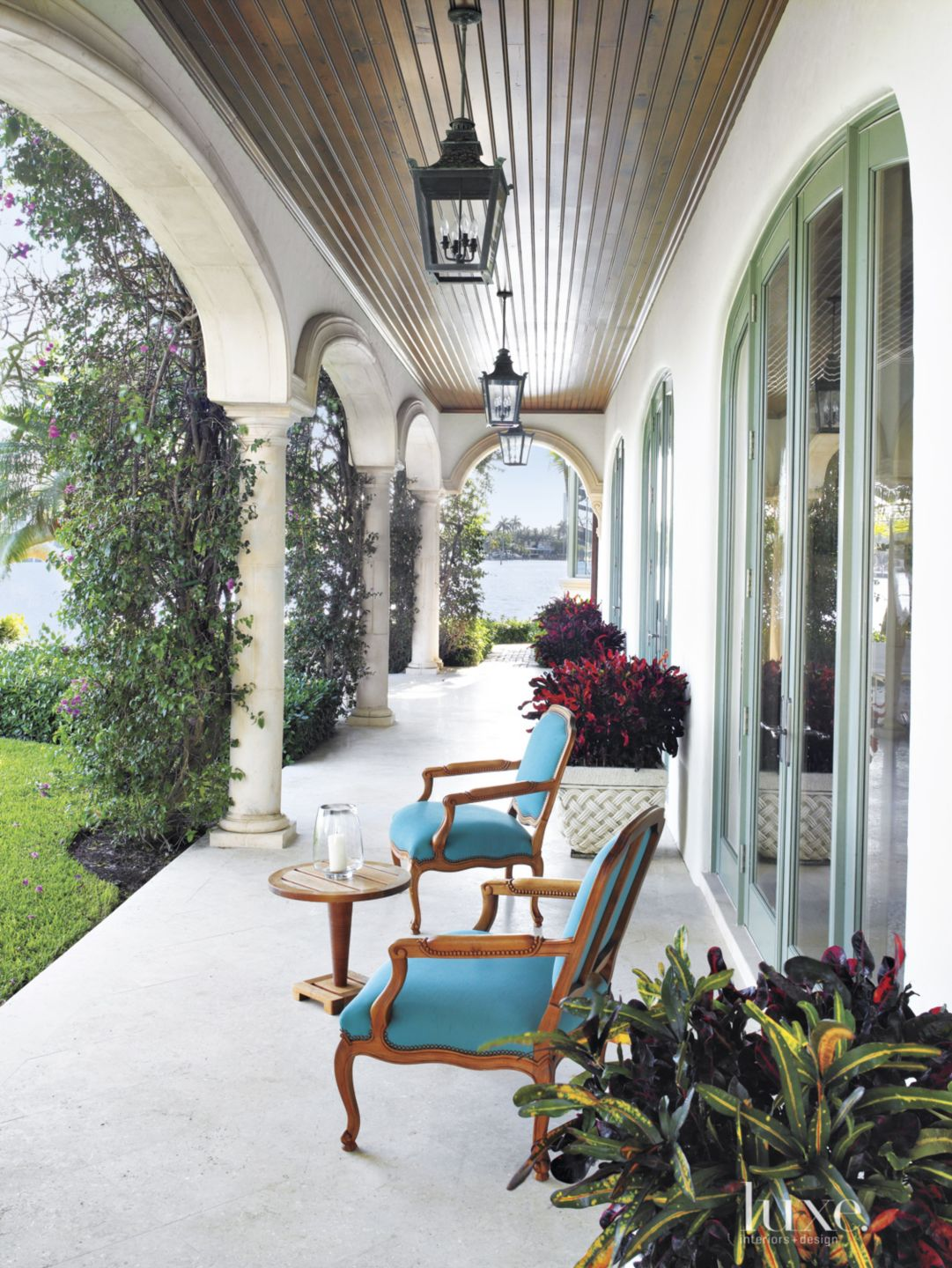 Traditional White Loggia with Teal Accent Seating