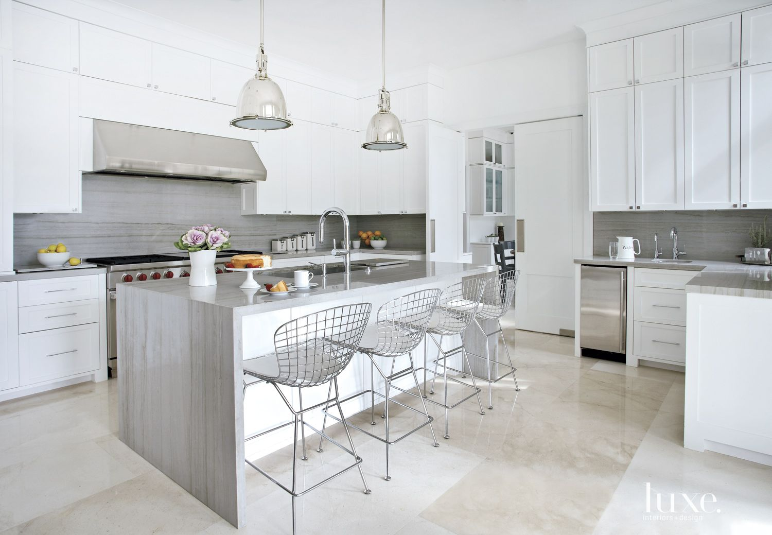 Contemporary White Kitchen with Gray Stone Backsplash and Countertops