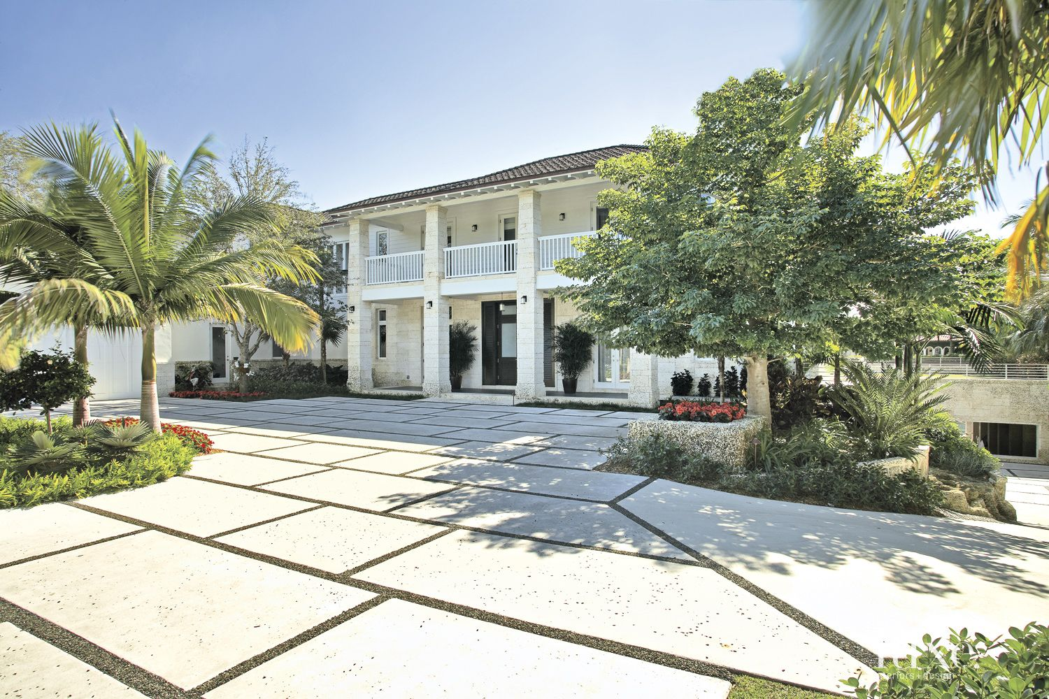 Plantation-Style White Exterior with Tropical Landscaping