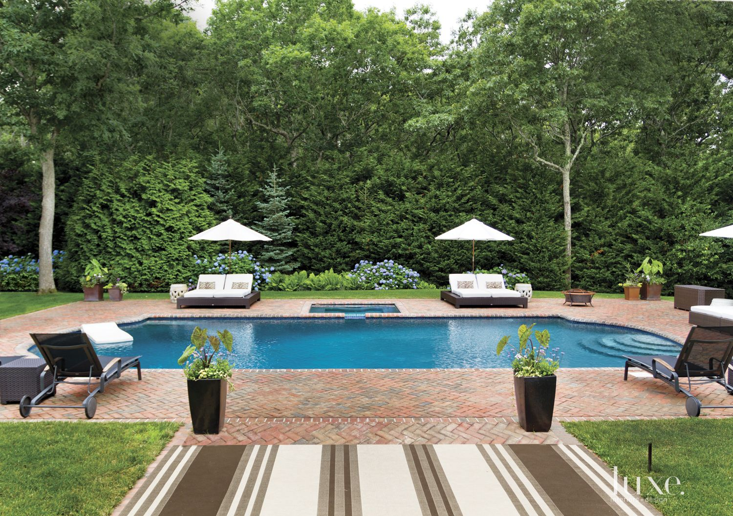 Contemporary Neutral Poolside with Brick Surround