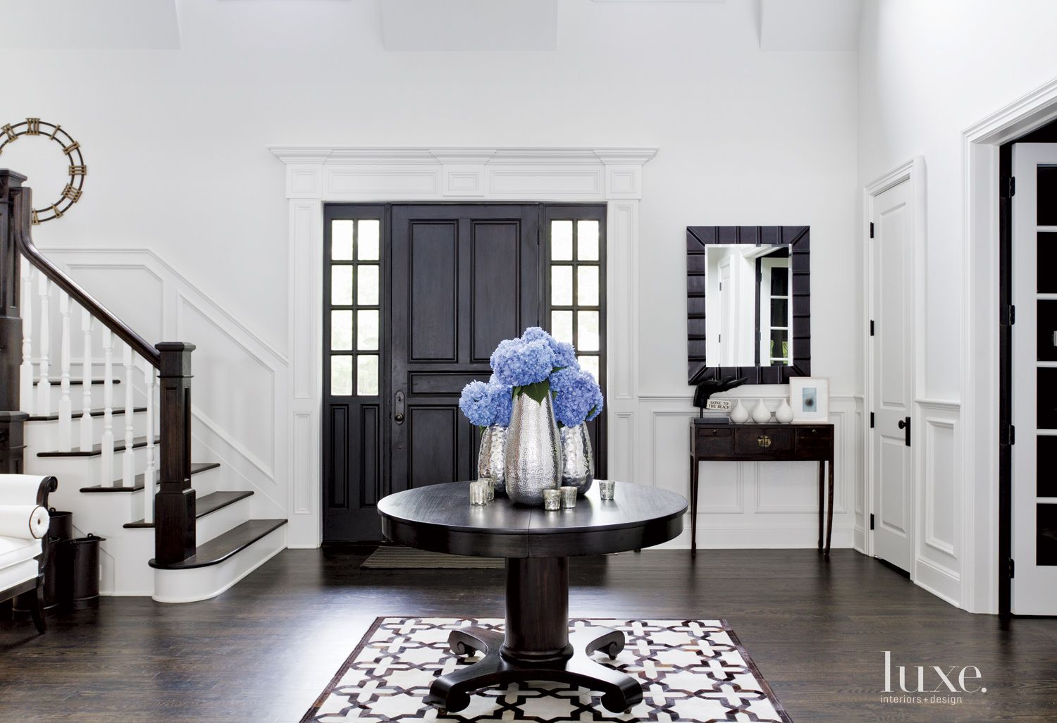 Contemporary White Foyer with Antique Center Table