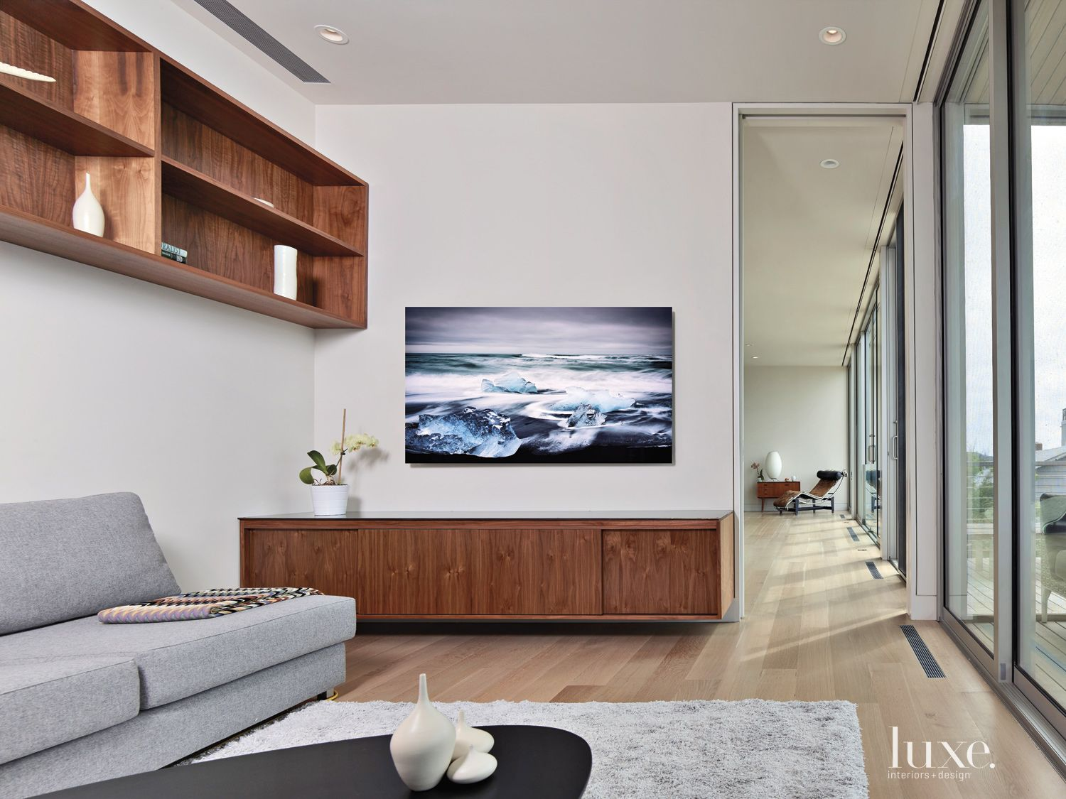 Modern White Family Room with Floating Sideboard