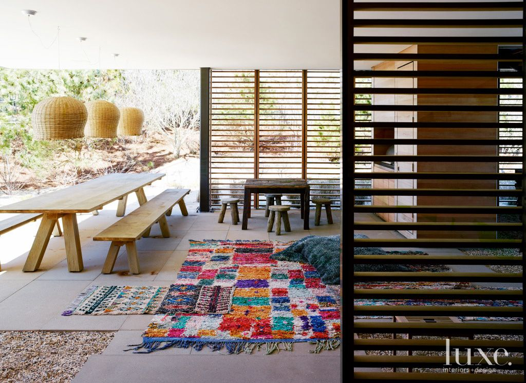 Contemporary Covered Patio with Knotted Rag Rug